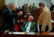 N.C. Rep. Roger West (center), a Republican who represents Cherokee, Clay, Graham and Macon counties, chats with state Rep. Bill Owens, D-Pasquotank, and lobbyist Zeb Alley during a break on the House floor this spring.
