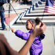 Promise Moseby, 4, waves a flag in the midst of the Martin Luther King Jr. Day events organized by the Martin Luther King Jr. Association of Asheville & Buncombe County. Colby Rabon/Carolina Public Press