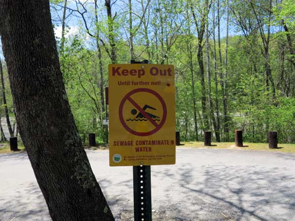 A sign warns the public to avoid using the French Broad River. Jon Elliston/Carolina Public Press