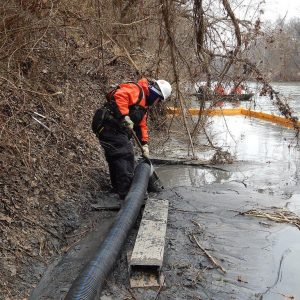 For a short time on Feb. 12, crews were able to remove coal ash from a section of the river bottom near the Dan River Steam Station in Eden, N.C. A vacuum system, hoses and a containment truck are being used to remove ash deposited in an approximate 25 by 75 foot section of the river shoreline near the plant. The work in this isolated, stable area will advance the overall removal effort as the company and state and federal agencies continue monitoring any impacts to the river to determine whatever additional steps might be needed. Info and photo from Duke Energy.