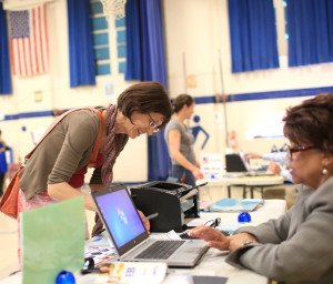 Leslie Shaw checks in at Isaac Dickson Elementary in Asheville to vote in the primary election on Tuesday, May 6, 2014. By 3:30 p.m., 200 voters had cast their ballots at the polling station, one of 80 in Buncombe County. Colby Rabon/Carolina Public Press