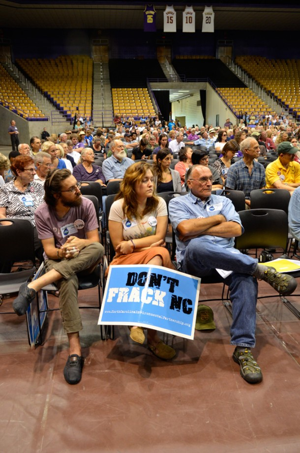 From making public comments to wearing buttons and holding signs, many attendees expressed opposition to fracking in North Carolina. Paul Clark/Carolina Public Press