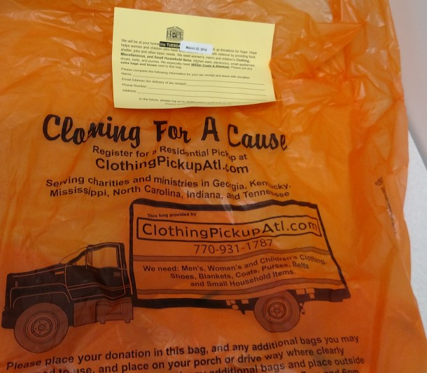 Orange bags like this one were distributed in March 2016 at homes in West Asheville and elsewhere. The donations are tied to an Atlanta-based group and don't benefit any domestic violence agencies in WNC. Frank Taylor / Carolina Public Press