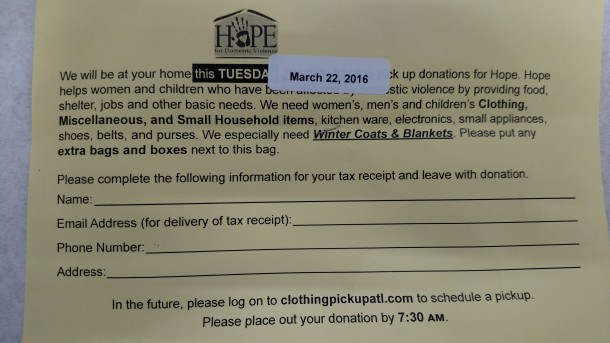 This card accompanied the donation bags that Nspire Outreach distributed in areas of Buncombe County in March 2016. Local agencies say the charity drive won't benefit them. Frank Taylor / Carolina Public Press