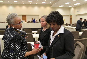 Sen. Terry Van Duyn huddles with Sens. Gladys Robinson, D-Guilford, and Valerie Fousheee, D-Orange, during a break in the hearing on Wednesday. Democratic senators later held a walkout to protest the bill before the final vote. Kirk Ross / Carolina Public Press