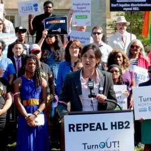 Buncombe County commissioner Jasmine Beach-Ferrara, an Asheville Democrat, speaks at a rally outside the old State Capital in Raleigh on Monday, April 25, 2016. HB2 opponents delivered petitions with 180,000 signatures calling for a repeal of the bill to Gov. Pat McCrory. Kirk Ross / Carolina Public Press