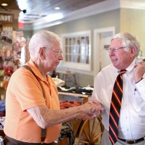 Franklin Mayor Bob Scott, right, shakes hands with John Wesley Davis at the Crabtree General Store on Wednesday afternoon, June 1, 2016. The mayor often leaves his downtown office to take strolls around town and check in with residents and tourists. Colby Rabon / Carolina Public Press