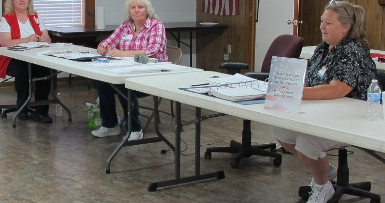 McDowell County election precinct judges (from left) Janet McGinnis, Tina Butler and Jeannie Elliot wait for voters to show up Tuesday, June 7, 2016, at the Crooked Creek Fire Department for the special primary vote. They said the turnout as of mid-afternoon was 65 out of nearly 2,400 registered voters in the precinct, which was still better than they had expected for the extra round of voting made necessary by court rulings earlier this year. Jessica Coates / Carolina Public Press