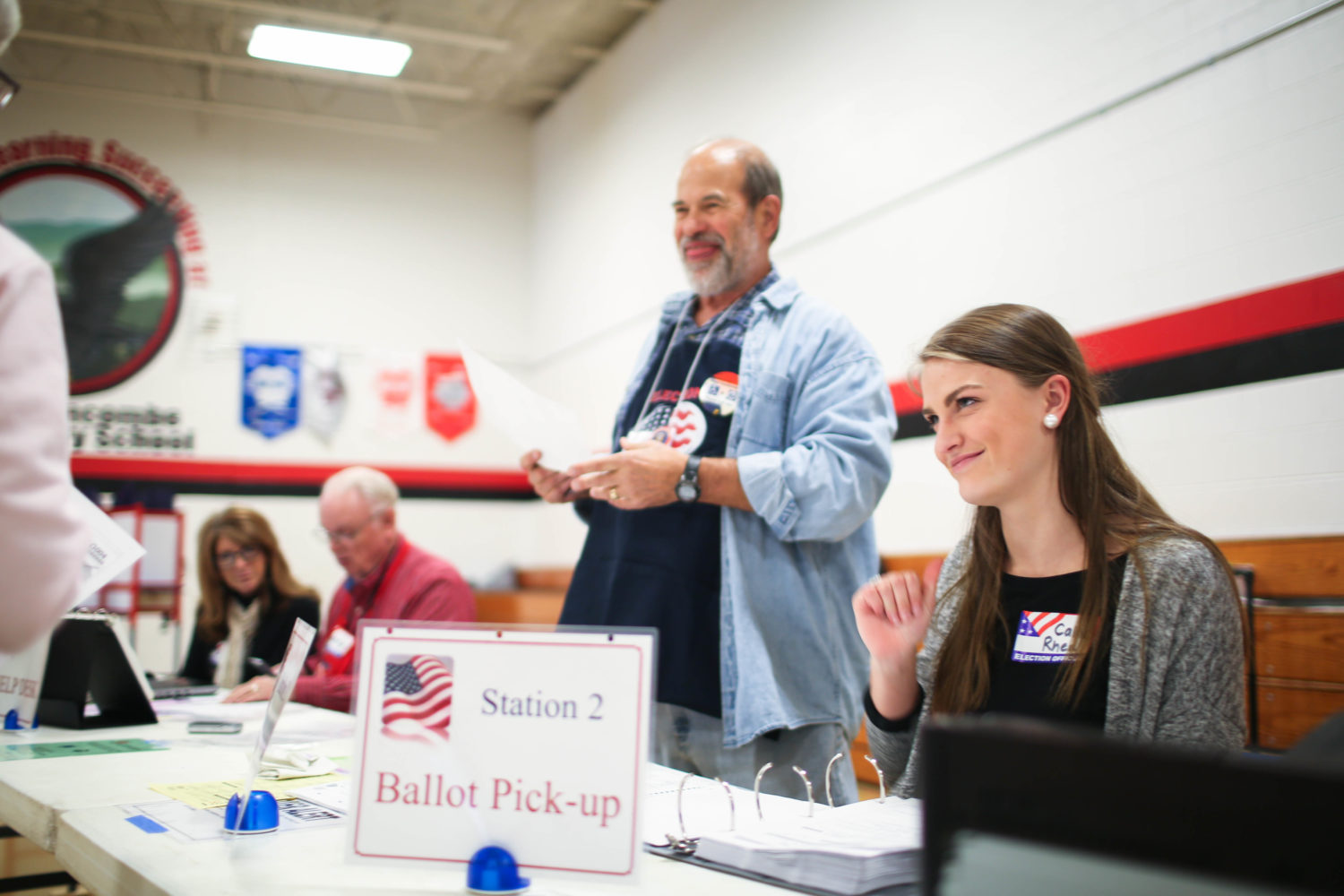 Student election assistant Callie Rhea helps to sign in voters at North Buncombe Elementary School in Weaverville on Tuesday. Rhea was volunteering at the precinct through her Civics class at North Buncombe High School. Colby Rabon / Carolina Public Press