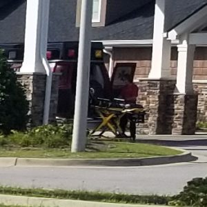 A resident is placed into an ambulance outside Gabriel Manor in July 2014.