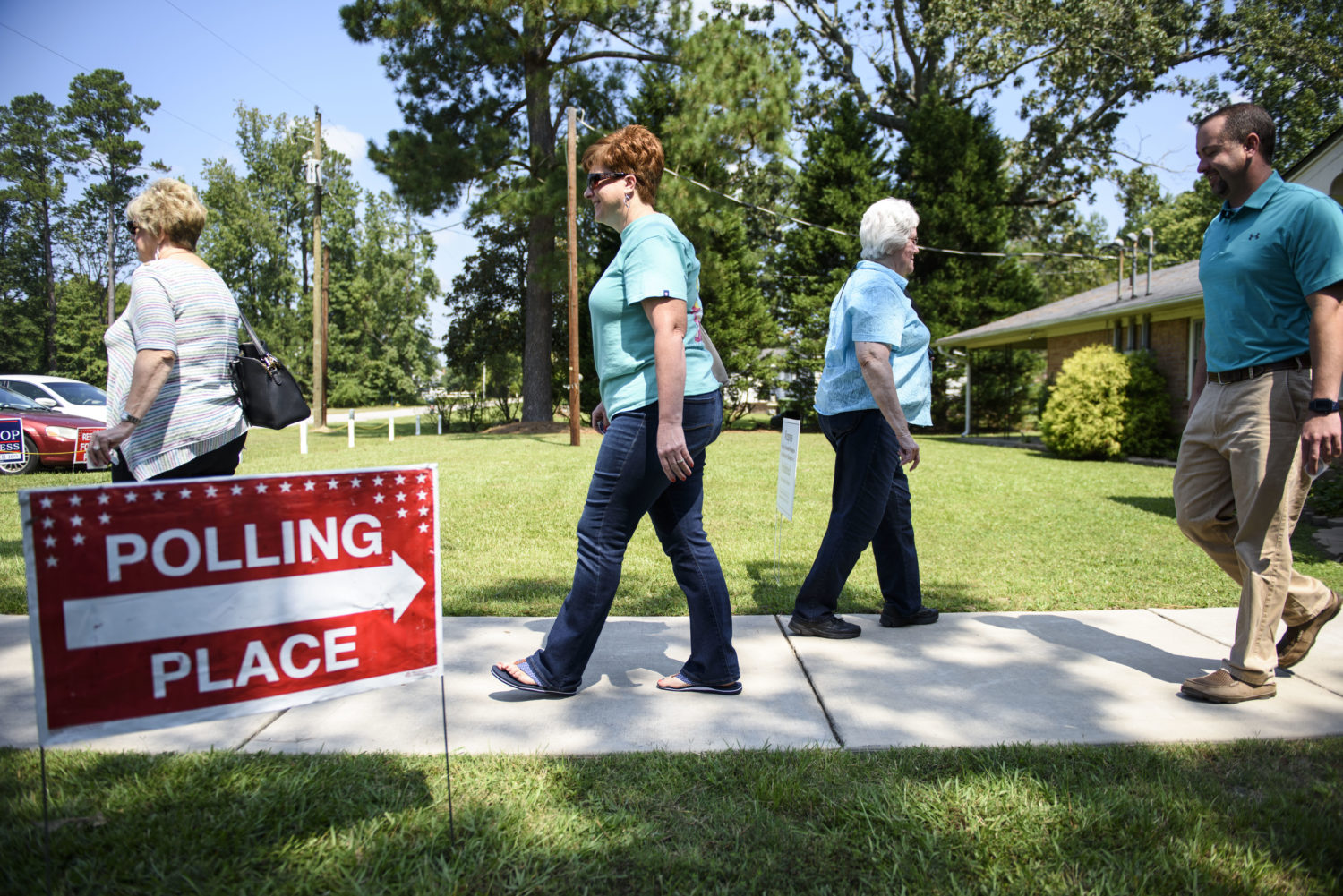 People enter and exit a polling station in Stedman on September 10, 2019, for a special election for the 9th congressional district. Certain guidelines will help voters in all elections. Melissa Sue Gerrits / Carolina Public Press