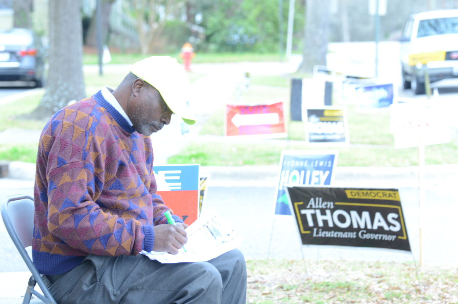 Edgecombe County Commissioner candidate Calvin Sherrod prepares sample primary election ballots for potential voters outside the Edgecombe County Administration Building in Tarboro on March 3, 2020. Calvin Adkins / Carolina Public Press