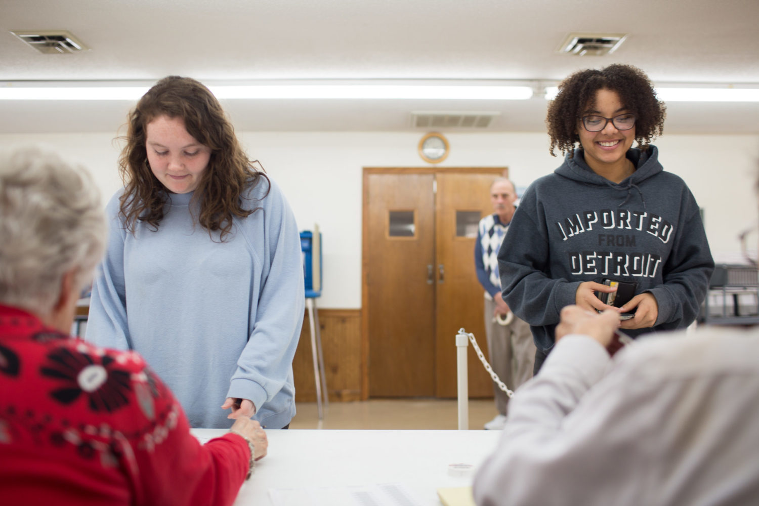 Lanie Hamrick, left, and Destinee Terry, both students at Asheville-Buncombe Technical Community College, check in to pick up their primary election ballots at the Old Fort Wesleyan Church polling place in McDowell County on March 3, 2020. Colby Rabon / Carolina Public Press