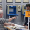Nash County poll worker Jim Martin instructs Jose Negron as he prepares to vote in the 2020 primary election at the Braswell Memorial Library polling place in Rocky Mount on March 3, 2020. Calvin Adkins / Carolina Public Press