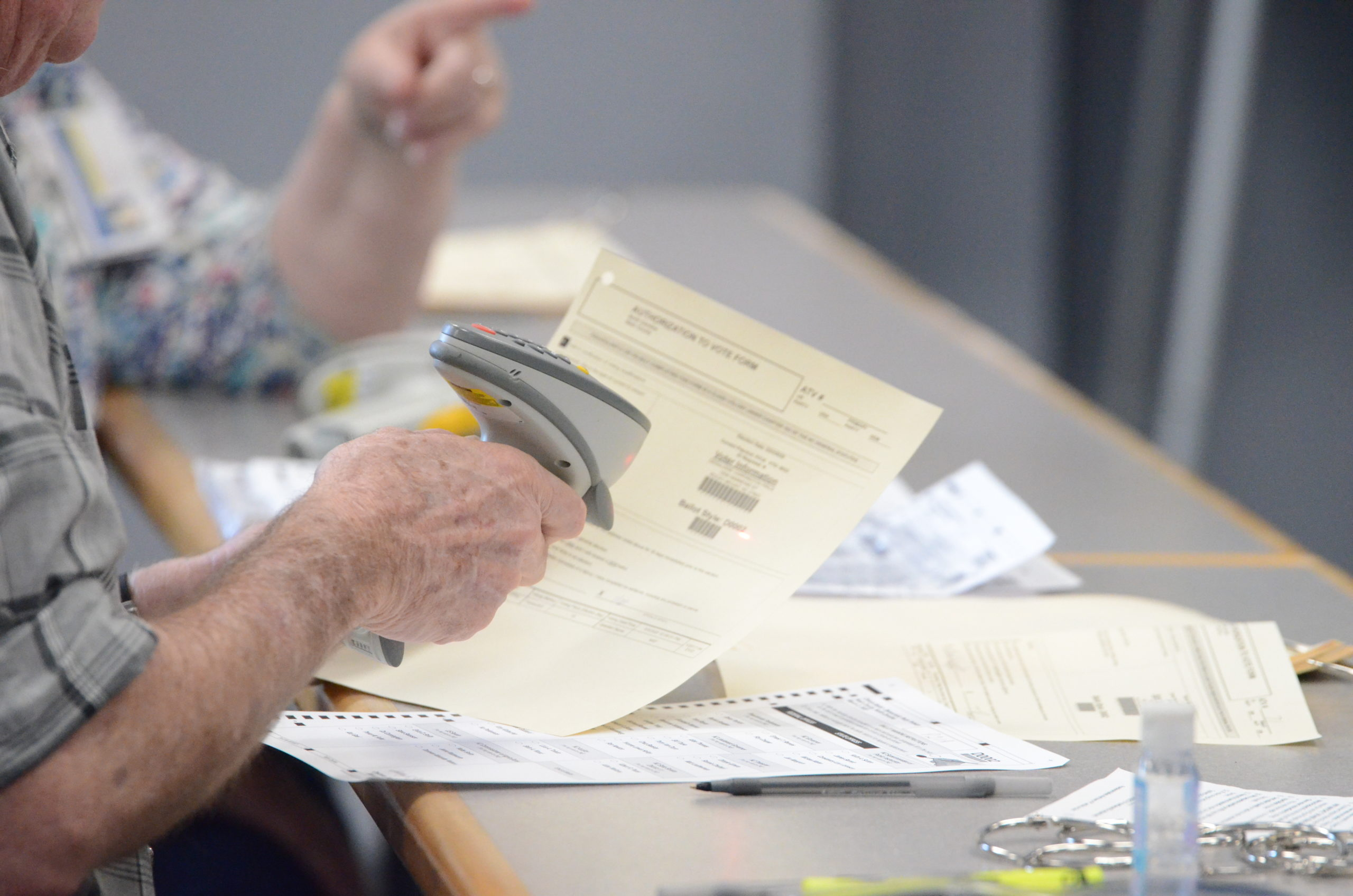 A poll worker in Nash County scans 2020 primary election voters' paperwork before giving them ballots at the Braswell Memorial Library polling place in Rocky Mount on March 3, 2020. Calvin Adkins / Carolina Public Press