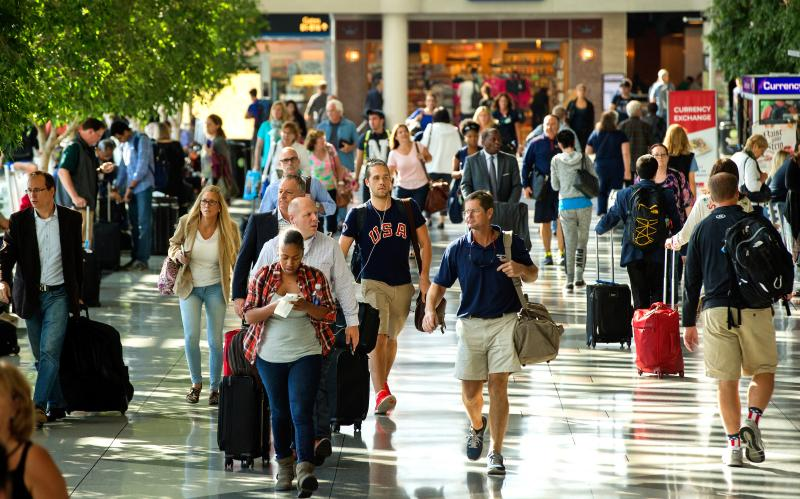 Flyers hurry through Charlotte-Douglas International airport to catch their planes on a busy day. Passenger traffic by all modes of travel has fallen off due to the coronavirus pandemic, but freight traffic is up. Photo courtesy of Charlotte-Douglas International Airport