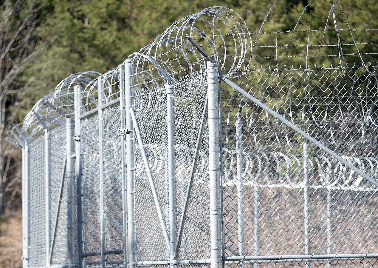 Razor-wire tops a security enclosure outside the Cherokee County Detention Center in Murphy. The confinement of many inmates in close quarters at jails creates public health and legal issues during the coronavirus pandemic. Colby Rabon / Carolina Public Press