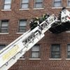 An Asheville Fire Department team uses a ladder to conduct a rescue during a recent downtown fire. An online platform that Asheville piloted and Buncombe County launched last week will allow those seeking help to provide important information to firefighters, such as if someone in the residence has coronavirus. Photo courtesy of the city of Asheville