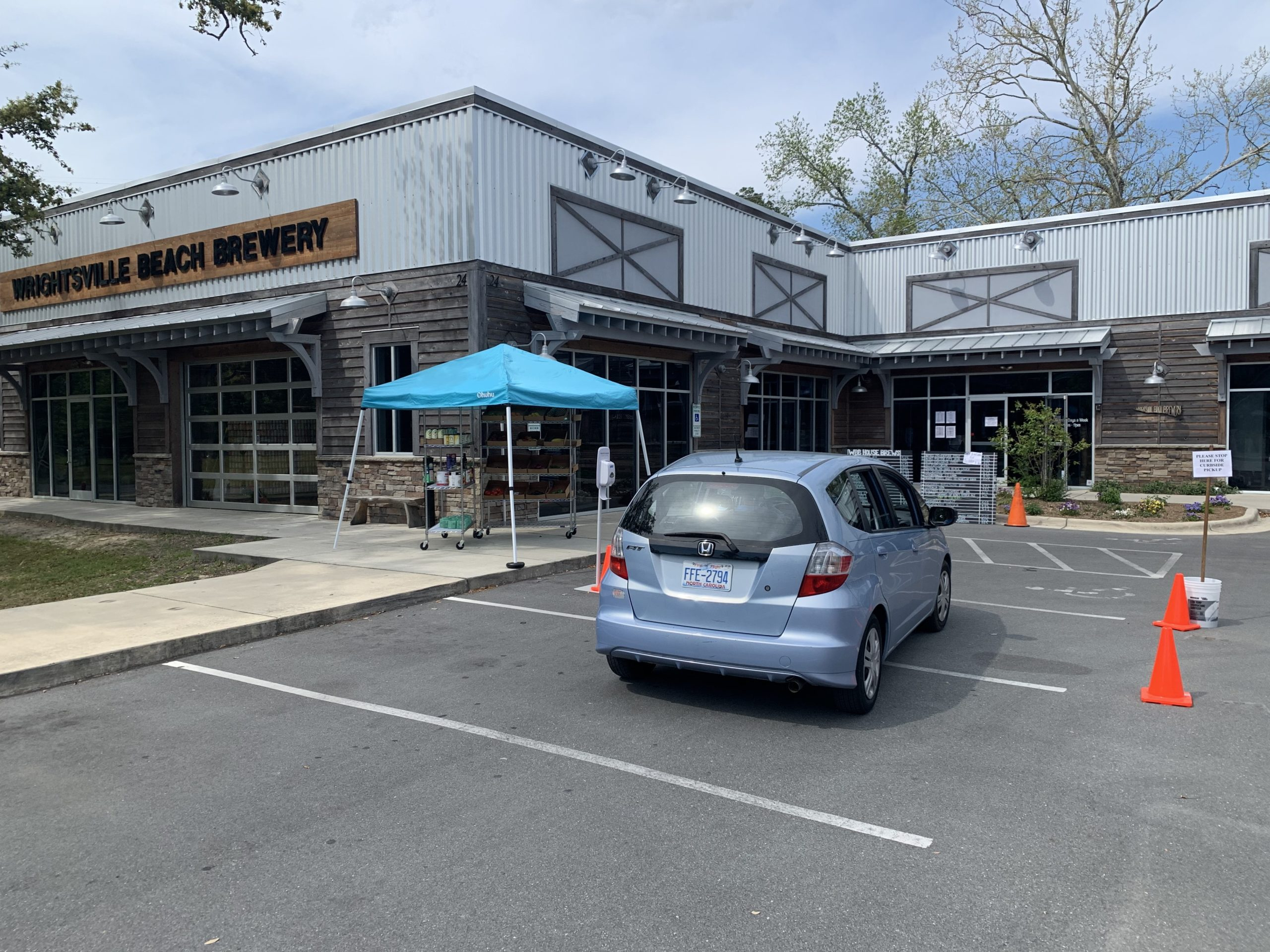 Jud Watkins, owner of Wrightsville Beach Brewery, has converted his business into a drive-through for beer, groceries and pizza. While many business owners have been confused by how lenders are processing new Paycheck Protection Program applications, Watkins thinks the program may prove counterproductive for the hospitality industry.