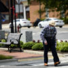 A man walks through downtown Goldsboro, on May 15. Some stores there have opened and many restaurants show signs for take out orders. Melissa Sue Gerrits / Carolina Public Press