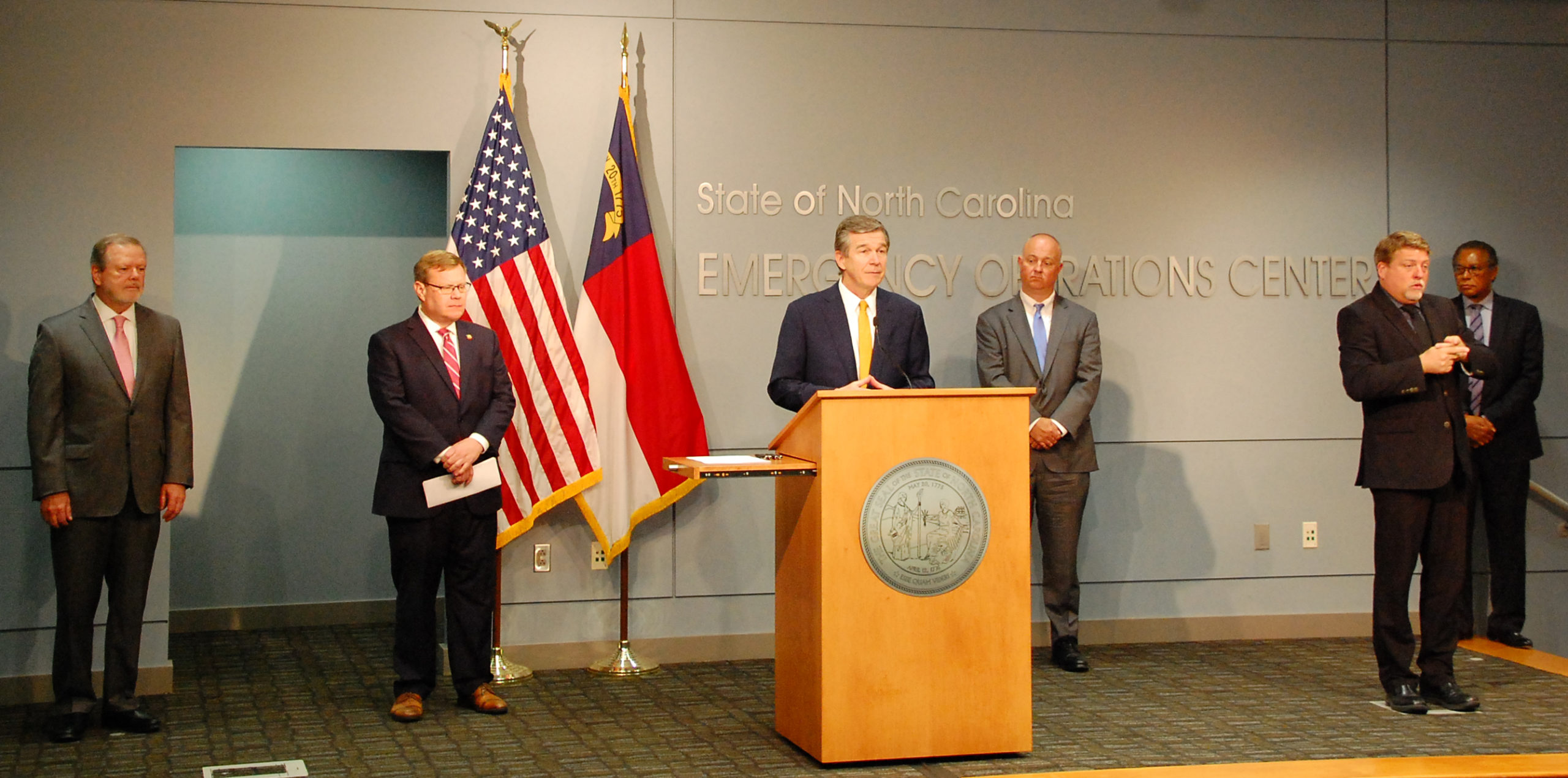 Gov. Roy Cooper and legislative leaders conduct a rare joint and bipartisan press conference Monday to announce passage of coronavirus response bills. Photo courtesy of the governor's office.
