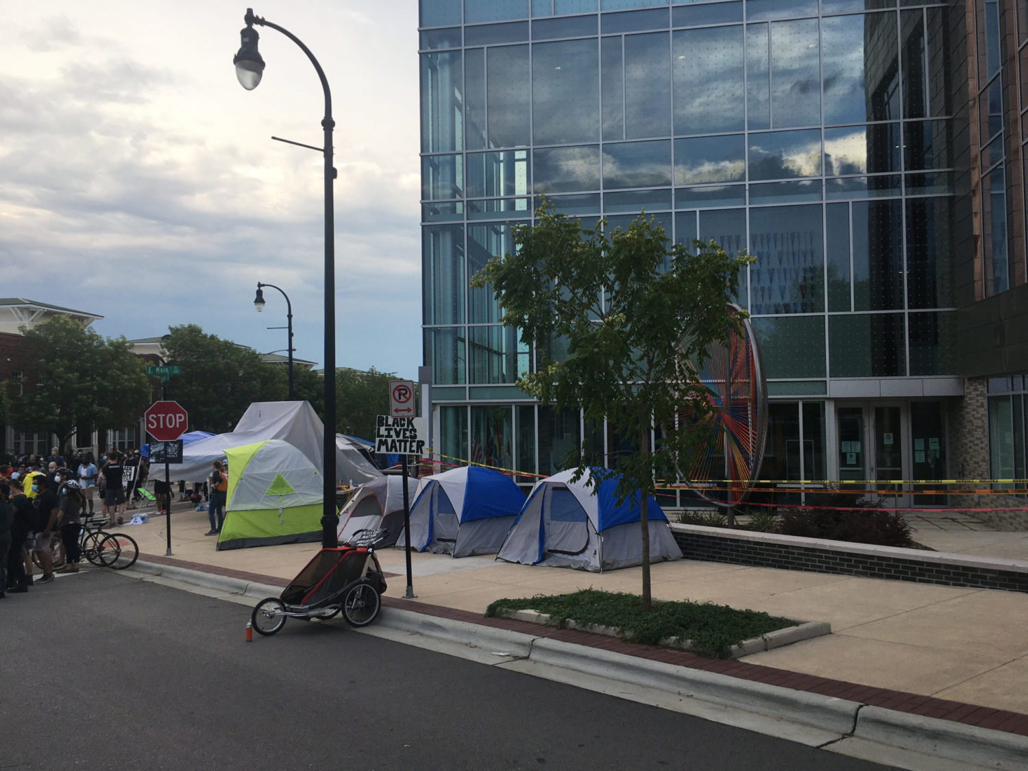 Durham residents started camping outside the police department on Monday night, June 15. The action was spontaneous and the camp has grown to include about a dozen tents and awnings. This protest has not garnered much support from more established organizers in the city.